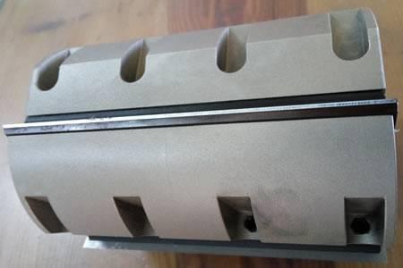 Portacuchillas con cuchillas reversibles para trabajar en moldureras